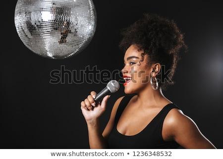 Gyönyörű afrikai nő áll ezüst diszkógömb Stock fotó © deandrobot