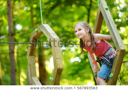 an adorable little girl enjoying her time in park stock photo © lopolo
