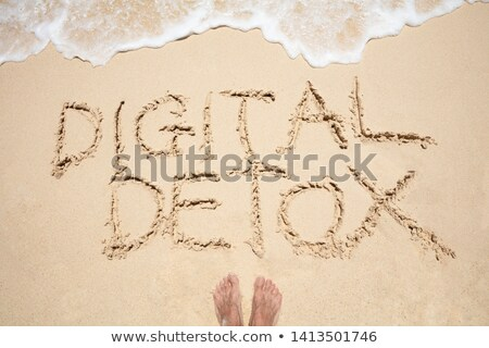 Person's Foot Near The Digital Detox Text Wave On Beach Stock photo © AndreyPopov