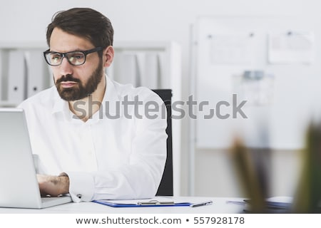 Stock photo: Close up of hand of business man working document and laptop in