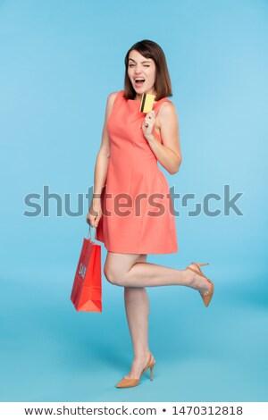 幸せ 小さな 気のあるそぶりをした 女性 赤いドレス ストックフォト © pressmaster