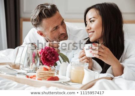 Szerető pár fürdőköpeny iszik kávé reggel Stock fotó © dashapetrenko