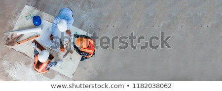 Architect working on blueprint, Engineer working with engineerin Stock photo © Freedomz