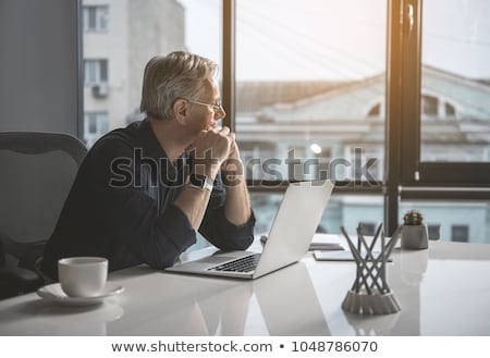 Contemplating businessman Stock photo © lichtmeister
