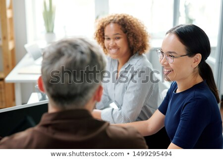Happy young multicultural businesswomen listening to their boss or colleague Stock photo © pressmaster