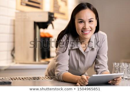 Joli jeunes réussi entrepreneur touchpad regarder Photo stock © pressmaster