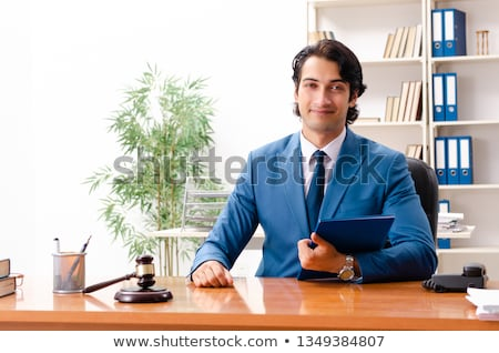 the young handsome judge sitting in courtroom stock photo © elnur