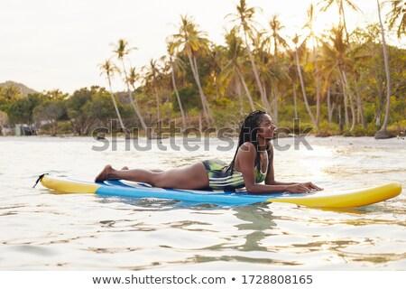 женщину Бикини сидят доска для серфинга песок Сток-фото © dash