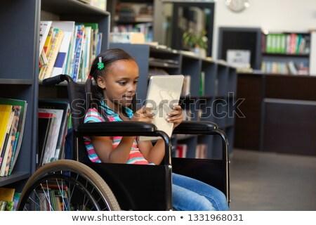 вид сбоку инвалидов школьница цифровой таблетка библиотека Сток-фото © wavebreak_media