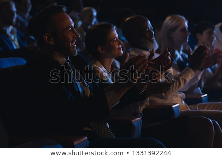 Side view of mixed race business colleague sitting together and clapping hands in the auditorium  Stock photo © wavebreak_media