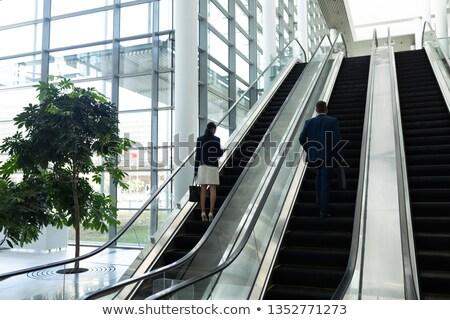 Hátsó nézet üzletember üzletasszony mozog mozgólépcső iroda Stock fotó © wavebreak_media