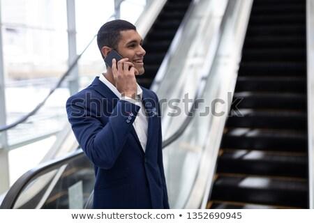 zarif · işadamı · cep · telefonu · ayakta · modern - stok fotoğraf © wavebreak_media