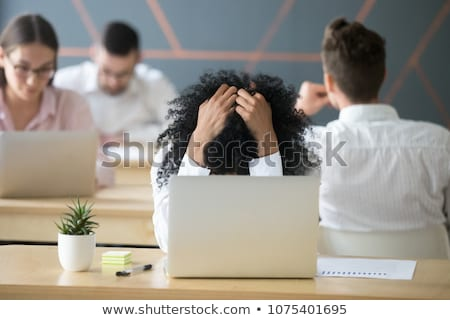 overwhelmed african american girl holding to head Stock photo © dolgachov