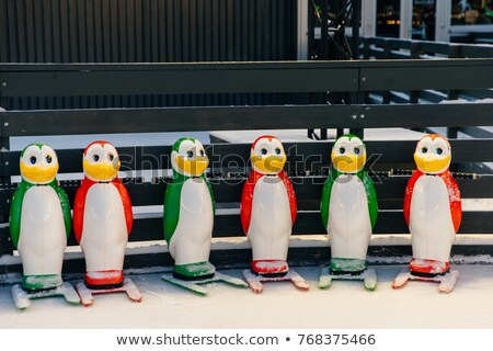 Row of skate aids for skate learners, made in shape of colorful penguins. Ice skating helpers. Figur Stock photo © vkstudio