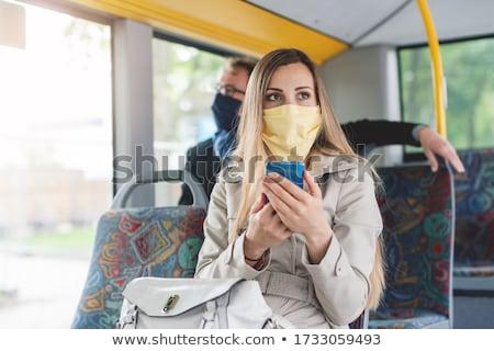 人 着用 マスク バス 公共交通機関 女性 ストックフォト © Kzenon