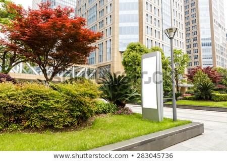 Anúncio edifício moderno cidade rua vidro assinar Foto stock © cozyta
