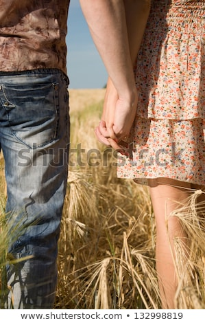 Pair in tield with wheat in hands Stock photo © Paha_L