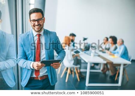 Boldog üzletember papír hírek öltöny munkás Stock fotó © leeser