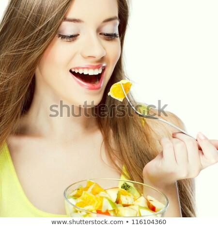 kobieta · puchar · sałatka · owocowa · biały · żywności · uśmiech - zdjęcia stock © hasloo