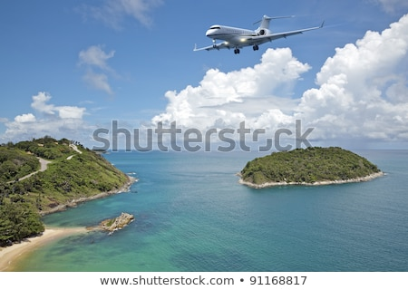 private jet plane is going to land at the airport of a tropical stock photo © moses