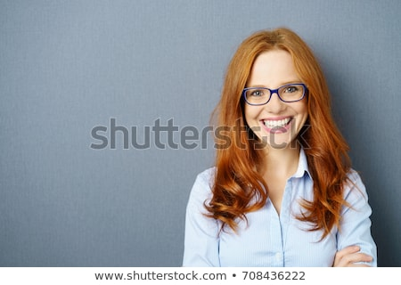 portrait of young pretty business woman against grey background stock photo © hasloo