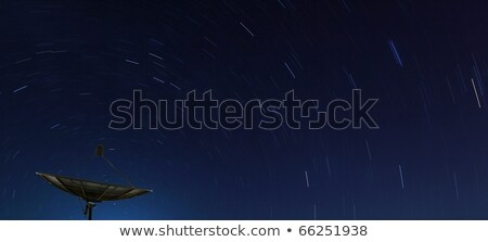 Conceptual Of Big Black Satellite Over Spiral Star At Night Stok fotoğraf © vichie81