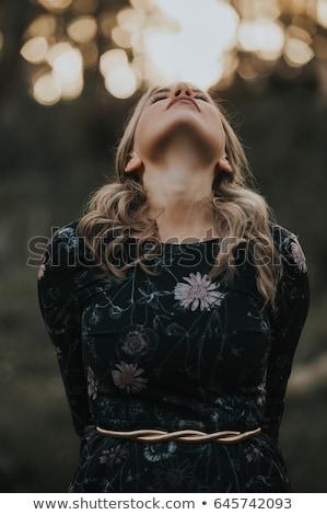 Beautiful Blonde With Head Tilted Back Stock photo © stryjek