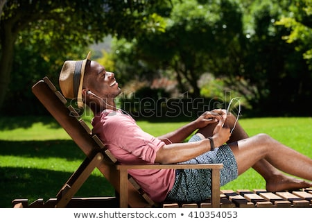 Man relaxing in park with headphones Stock photo © photography33