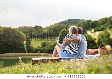 maduro · casal · piquenique · cara · floresta · pão - foto stock © photography33
