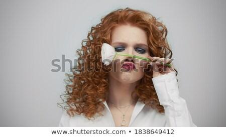 redhead girl with flowers indoor stock photo © massonforstock