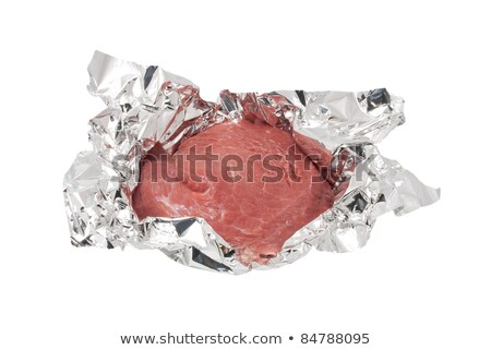 Piece of crude meat in a foil it is ready to preparation Stock photo © inxti