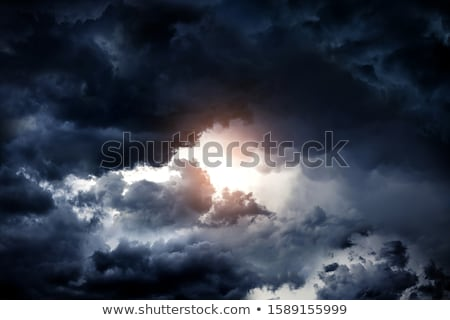 dramatic storm clouds with sun stock photo © artjazz