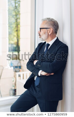 Pensive grey-haired man outside his house Stock photo © photography33
