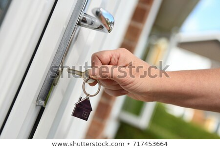 Woman unlocking a door Stock photo © photography33