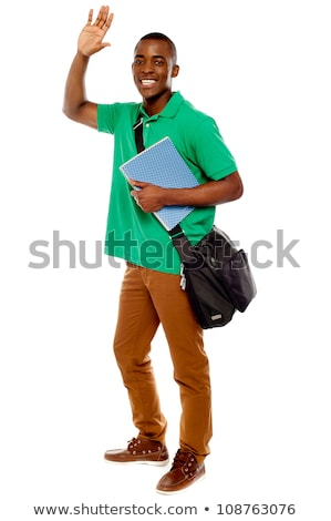 Cheerful student waving his hands. Enjoying himself Stock photo © stockyimages
