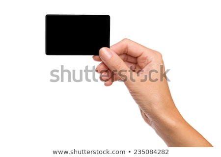 Business card in female hand. Studio isolated Stock photo © ozaiachin