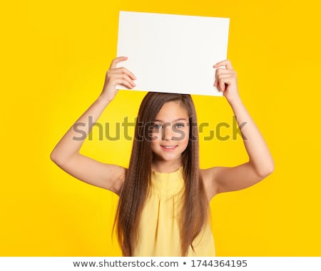 attractive young brunette with blank sign stock photo © lithian