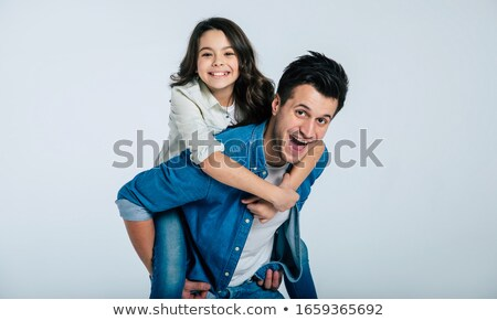 Close-up of little girl enjoying piggyback ride with her father Stock photo © wavebreak_media