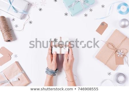 christmas girl with silver gift box stock photo © photosebia