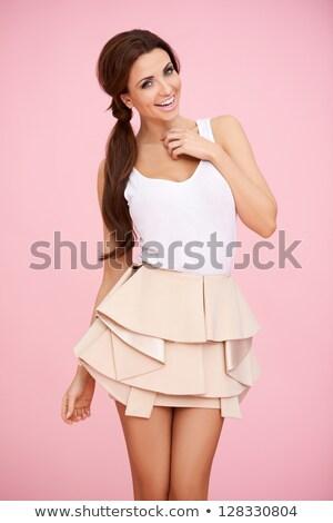 Minifalda jóvenes mujer sexy posando negro Foto stock © acidgrey
