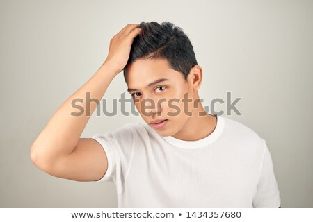 man with hand through hair stock photo © feedough
