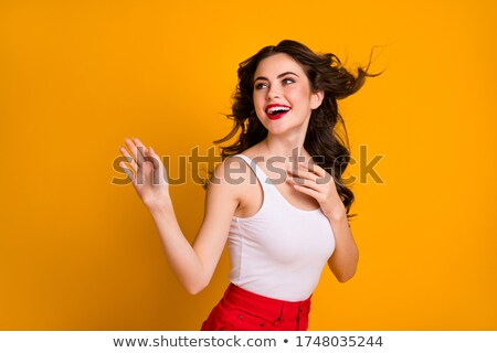 Happy Woman Waving Arms in the Air Stock photo © ArenaCreative