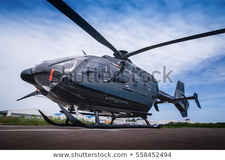 Stockfoto: Commercial Helicopter Flying In The Sky
