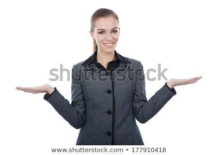 Stock photo: Fashionable young lady indicating sideways