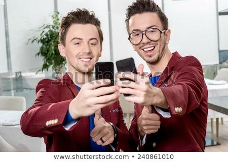 Komórka bliźnięta dwa telefony komórkowe odizolowany biały Zdjęcia stock © winterling