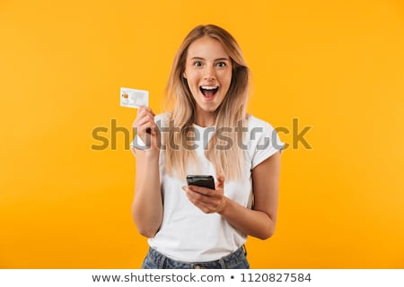 charming blonde smiling young woman on phone stock photo © pablocalvog