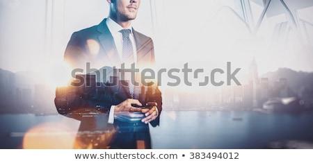 üzletember okostelefon üzlet épület férfi okostelefon Stock fotó © adamr
