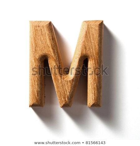 wooden alphabet - letter M on white background Stock photo © ozaiachin