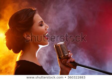 Pretty woman singing at concert Stock photo © Aikon
