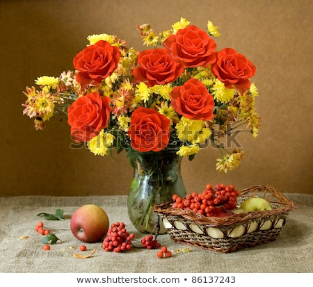 bouquet of scarlet roses in vase with gift basket Stock photo © neirfy